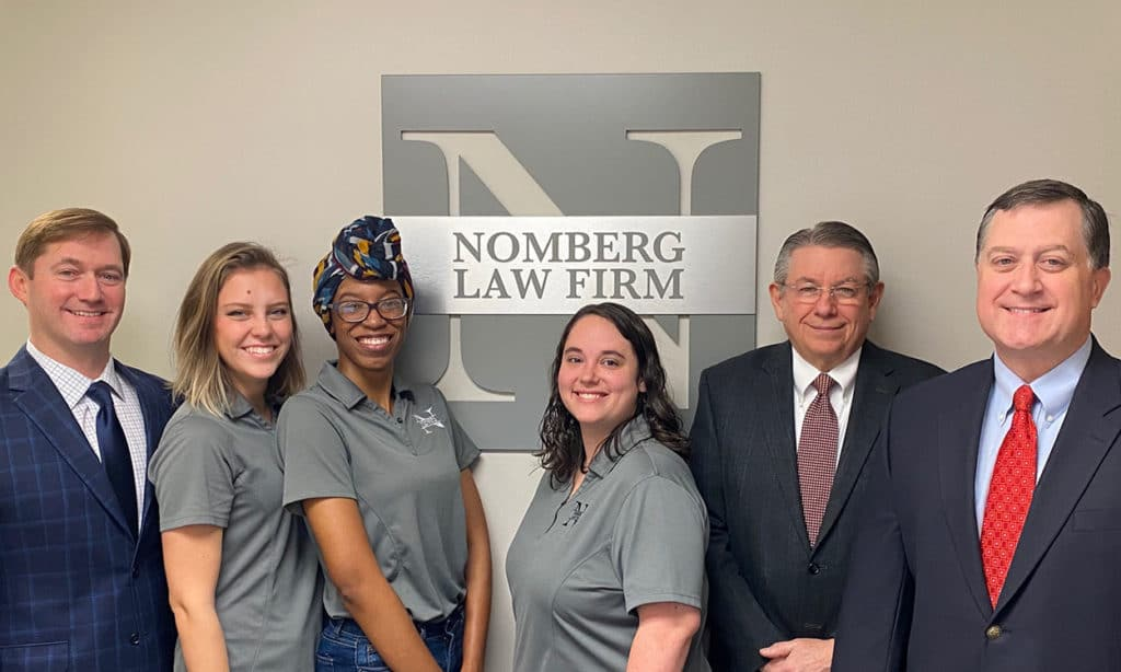 photo of the nomberg law firm staff and attorneys