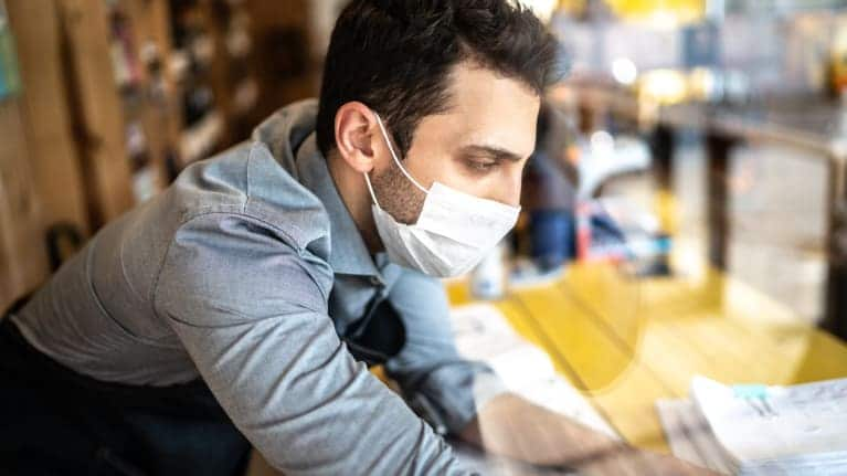 photo of a man wearing a mask during pandemic at work
