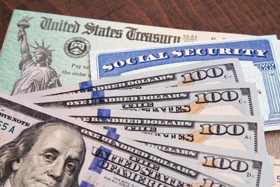 a photo of dollar bills and a social security card